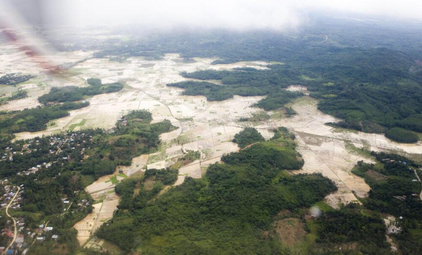 View from the plane of East Kalimantan. Clear pockets of land show deforestation.